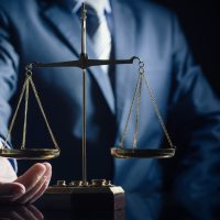 Weight,Scale,Of,Justice,,Lawyer,In,Background.,Justice,Law,Lawyer